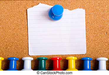 Note on Bulletin Board - A torn white note stuck to a...