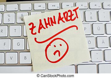note on computer keyboard: dentist