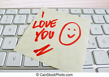 note on computer keyboard: i love you
