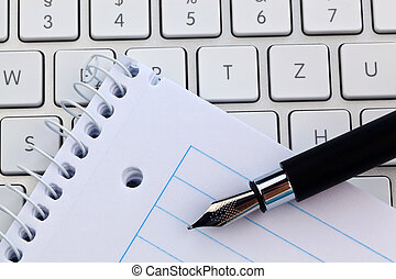 note pad and keyboard of a computer - a notepad and keyboard...