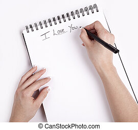 Note Pad with a hand write on it I Love you.