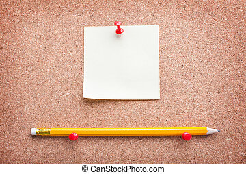 note paper on cork board with pencil
