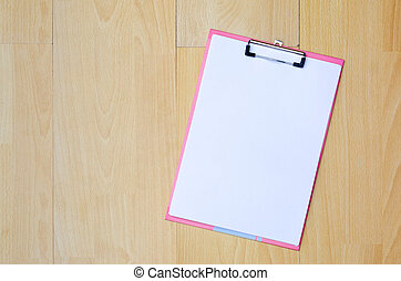 Note paper top view on a wooden
