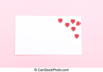 Note with candies in the form of a heart. Valentine's Day