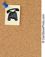 note with telephone symbol posted on corkboard - telephone messages