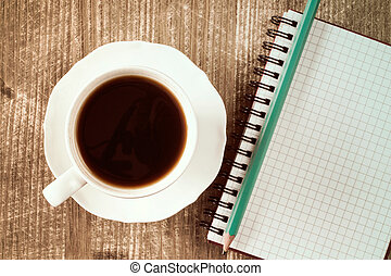 Notebook and coffee cup.