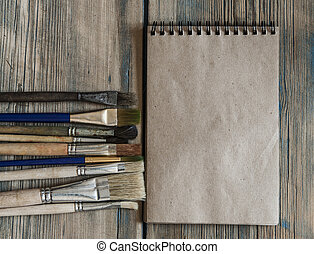 Notebook and school accessories on wooden background