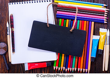 school supplies - notebook and school supplies on a table