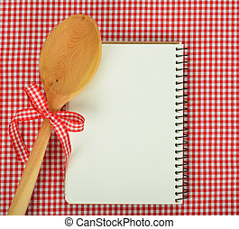 Notebook and wooden spoon