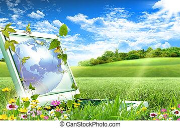 Notebook computer sitting on green grass