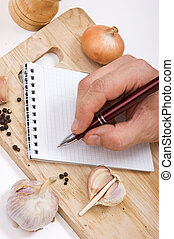 notebook for culinary recipes on a cutting board