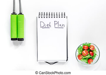 Notebook for diet plan, salad with fresh products and jump rope on white background top view mock up