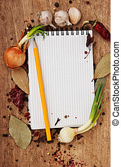 notebook for recipes and spices on an old wooden table
