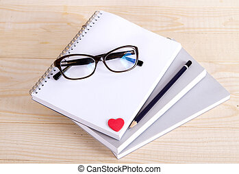 notebook glasses pencil heart.