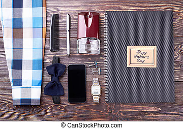 Notebook, greeting card and smartphone.