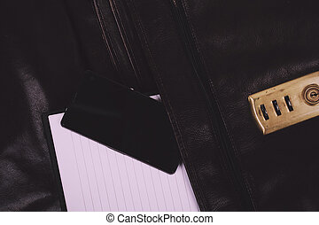 Notebook in an open brown leather briefcase Vintage Retro Filter.