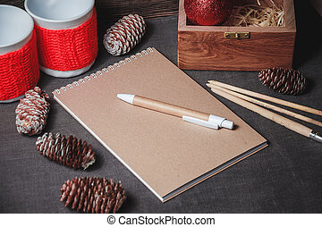 notebook in the center of cute Christmas decoration, cones