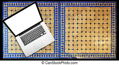 Notebook laptop on Two moroccan mosaic table