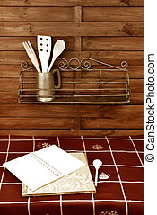 notebook of recipes in country kitchen