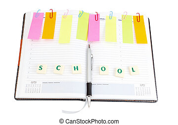 Notebook office organizer and reminder stickers with a ballpoint pen. With the word scool.