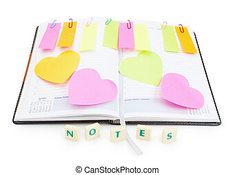 Notebook office organizer and reminder stickers with a ballpoint pen. With the word notes.
