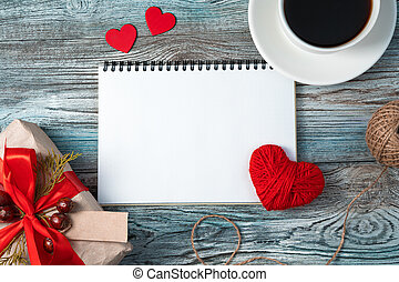 Notebook on a romantic background. Top view with space to copy.