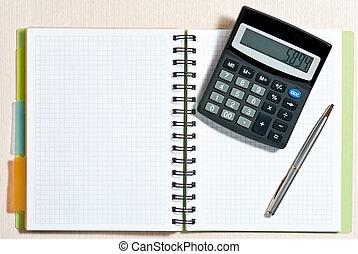 Notebook on desk - Notebook, ballpen and calculator on...