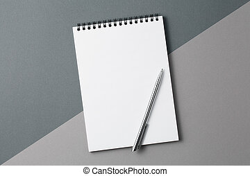 Notebook on two-tone gray background top view.