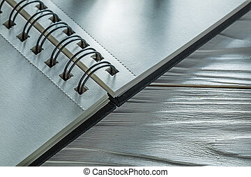 Notebook on white wooden board