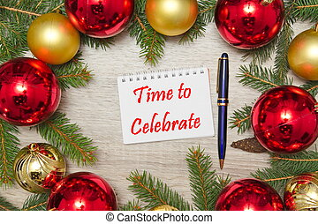 Notebook page with text TIME TO CELEBRATE with decoration on wooden office table