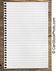 Notebook paper sheet. - Notebook paper sheet on a wooden...