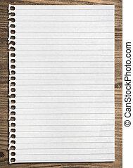 Notebook paper sheet. - Notebook paper sheet on a wooden...