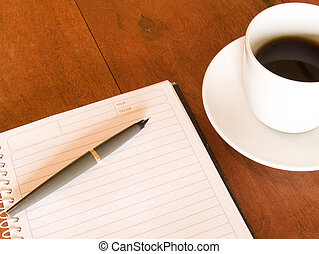 notebook, pen and coffee cup