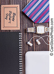 Notebook, striped tie and watch.