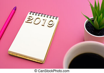 Notebook to describe the plans 2019 on purple background