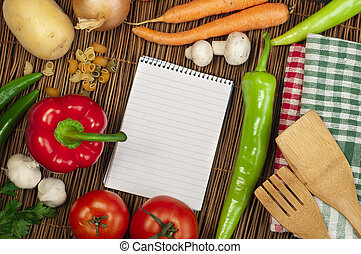 Notebook to write recipes and vegetables around it