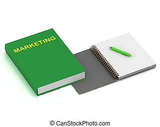 Notebook with a pen and a book on marketing