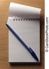notebook with a pen on the table