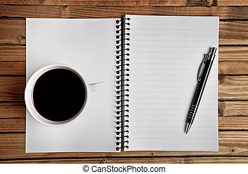 Notebook with coffee cup