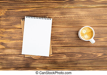 Notebook with coffee cup.