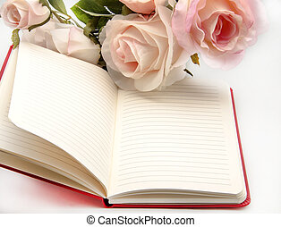 Notebook with flowers - Still Life with open notebook and...