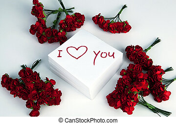 notebook with marker inscription I love you and roses