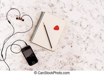 Notebook with music concept on white background. Top view