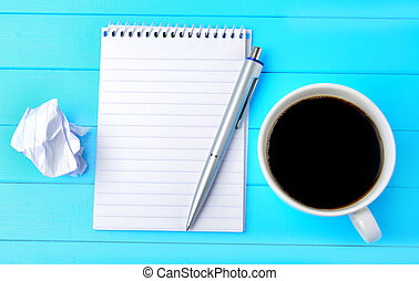 Notebook with pen and coffee cup