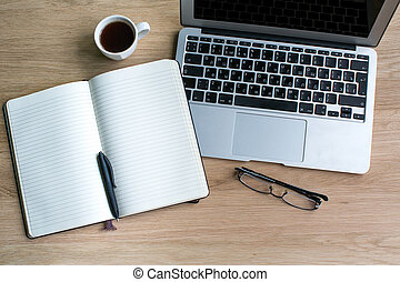 Notebook with pen, laptop, glasses