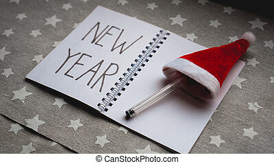 Notebook with pen to write goals of new year
