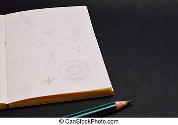 notebook with pencil sketches of christmas items