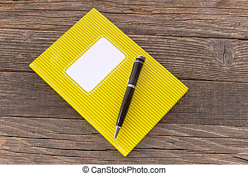 Notebook with pencile  on wooden background
