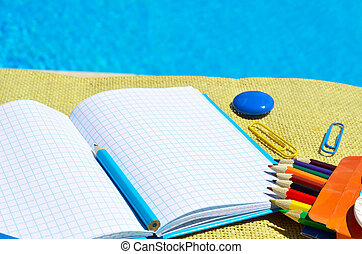 Notebook with school supplies.