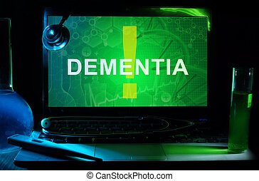 dementia - Notebook with words dementia , test tubes and...